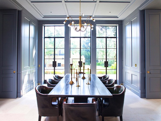 william hefner dining room paneled walls doors gray blue cococozy interior design leather chairs encasement windows interior design