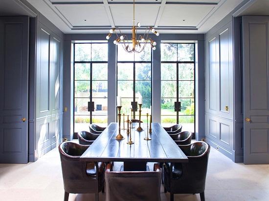 william hefner dining room paneled walls doors gray blue cococozy interior design leather chairs encasement windows interior design