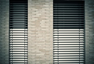 A photo of blinds taken from outside.