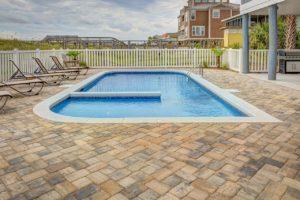 A photo of a small minimalist swimming pool